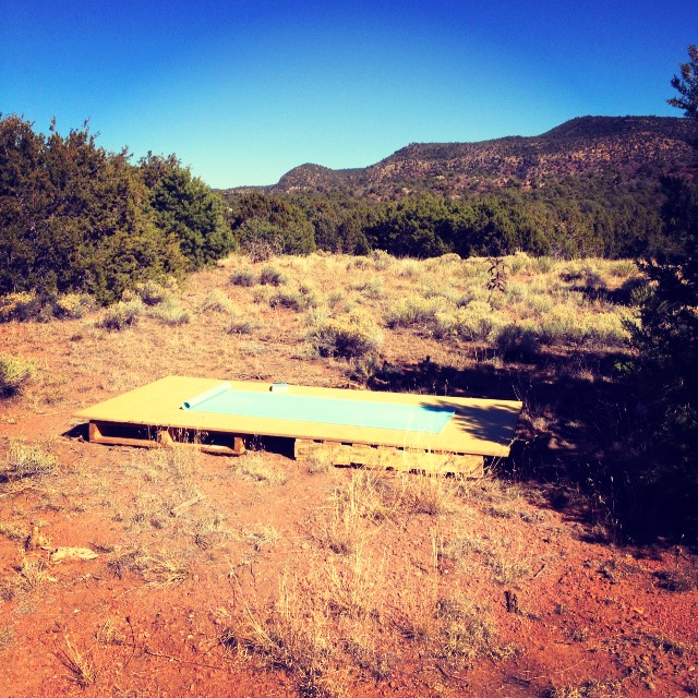 outdoor yoga platform behind our tiny house