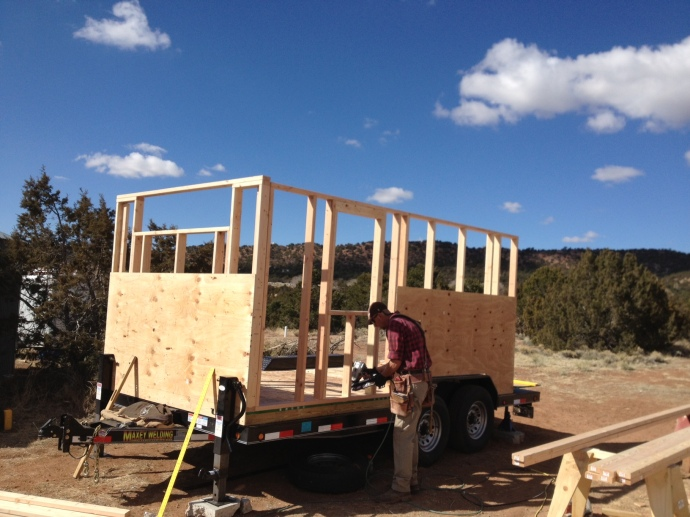 Two walls are framed and partially sheathed.