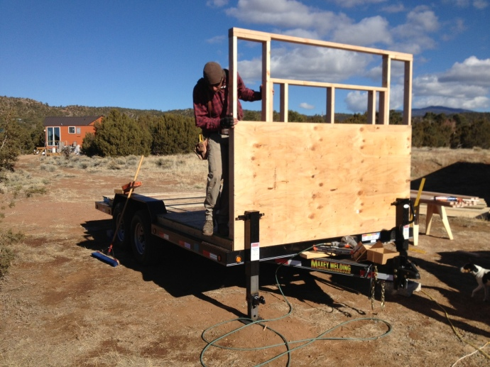 The first wall is up!  We squared it with one sheet of plywood prior to raising it.