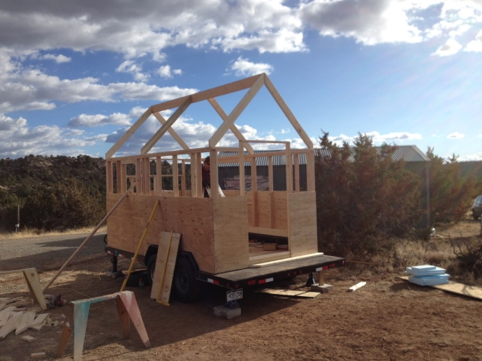 The ridgepole and several of the roof rafters are installed.
