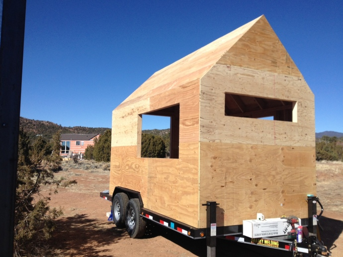 Beehive Mini Mart / Tiny House: wall sheathing.  the large window on the side is a 3'-0 x 6'-0 slider and will function as a serving window to patrons purchasing coffee or tea from outside.