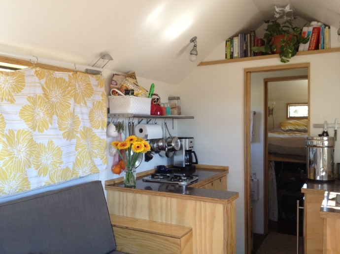 Tiny house interior: Kitchen and new curtains.