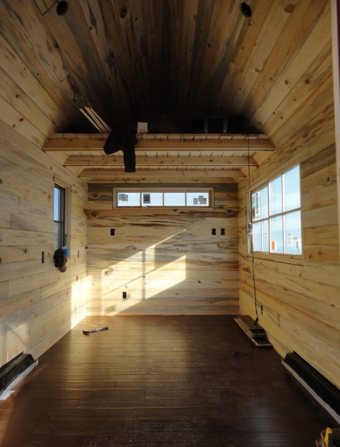 The wood flooring is installed in the Tiny House.  The floating installation gives it a soft cushy feel underfoot.