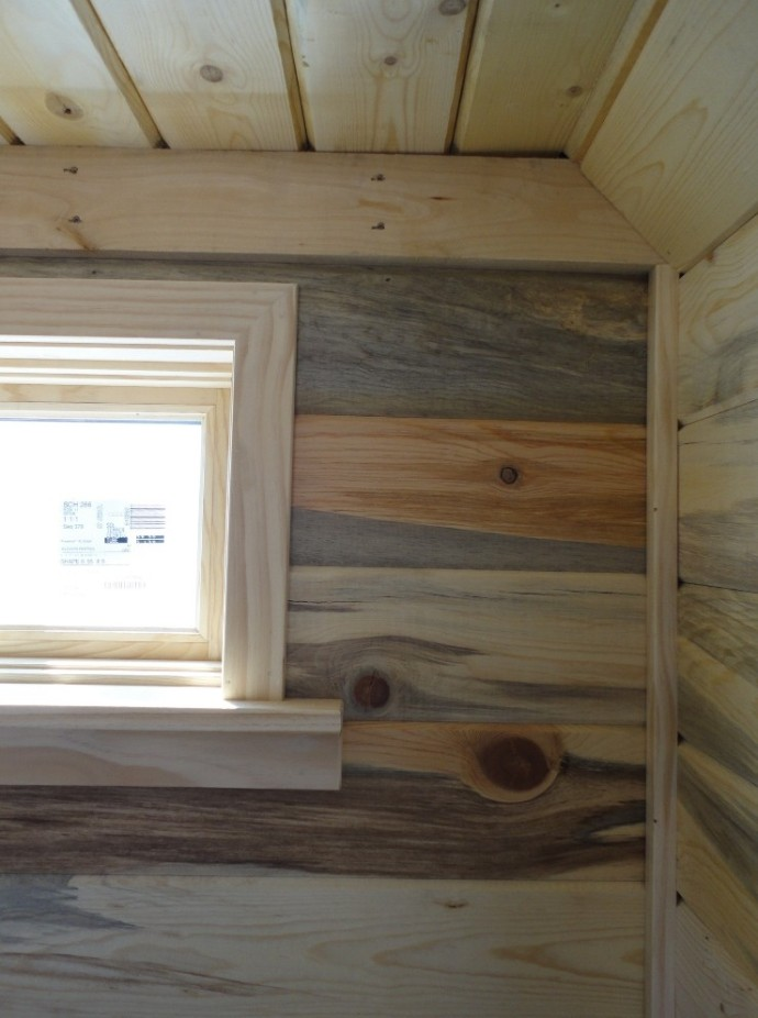 Tiny House window trim and beetle-kill / blue-stain pine wall paneling detail.  Pine loft overhead.  Look at the range of colors in the pine!  Shane really made a feature wall on the back highlighting the natural grain in the pine tongue-and-groove.