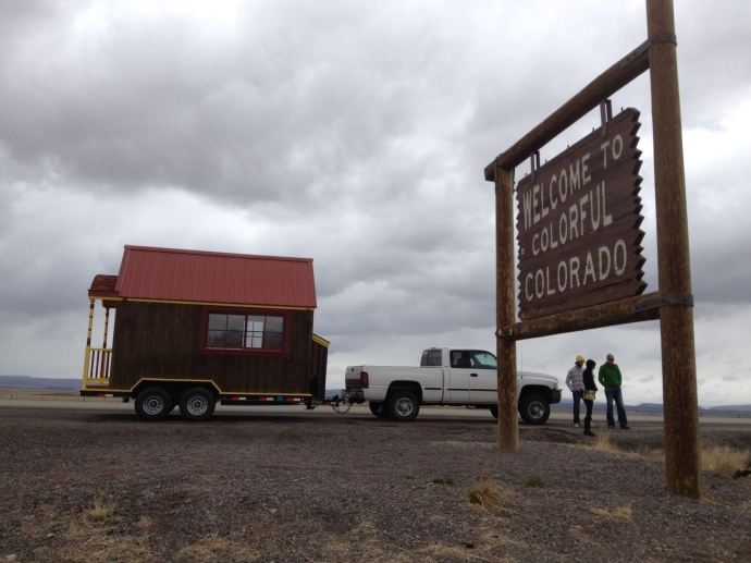 The tiny house on the move: at the Colorado-New Mexico border.