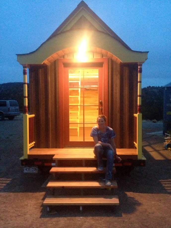 the finished tiny house at night...