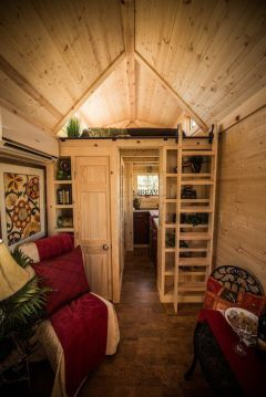 Many tiny houses are built like this Tumbleweed model called the Cypress.  The sleeping loft is located above the bath and kitchen and accessed by a ladder.