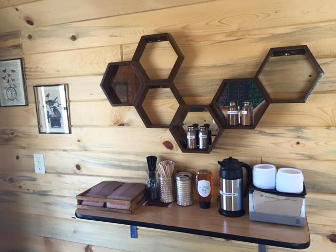 the honeycomb shelves are a nod to our original design for the Beehive Mobile Mini Mart.